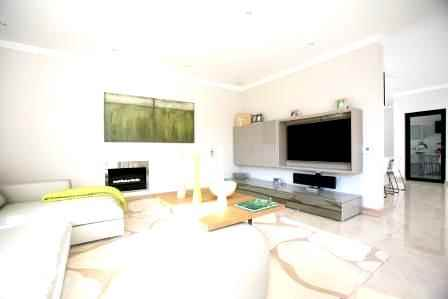 Home Theatre in a lounge Discreet Surround sound. Sound and Image Gauteng project.